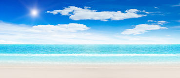 Tropical beach and ocean. Panoramic shot Stock Images