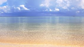 Ocean waves and cloudy sky background. Amazing tropical beach. White sand and crystal-blue sea video with sound. Tropical beach. Ocean waves and cloudy sky stock video