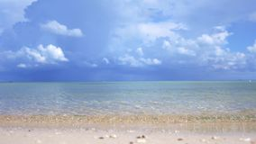Paradise landscape of amazing tropical beach. Ocean waves and cloudy sky background. White sand and crystal-blue sea. Tropical beach. Ocean waves and cloudy sky stock footage