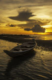 Tropical beach. Old style boat at sunset on a tropical island stock photography