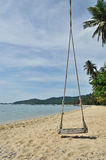 Tropical beach with Old Swing Tied to tree Stock Images