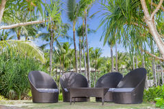 Tropical beach, outdoor cafe, chairs on beach Stock Photos