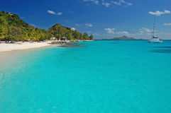 Tropical beach on Palm Island with catamaran Stock Image