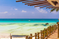 Tropical beach with palm trees and beach beds, Royalty Free Stock Images
