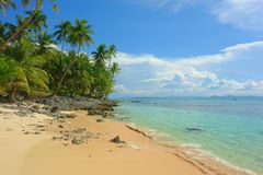 Tropical beach with palm trees. On the island of Siargao, Philippines Stock Photos