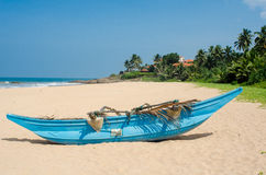 Tropical beach with palms and boats in Sri-Lanka Royalty Free Stock Images