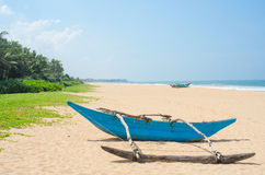 Tropical beach with palms and boats in Sri-Lanka Stock Photo