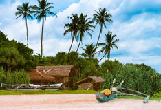 Tropical beach with palms and fishing boats . Stock Image