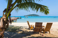 Tropical beach panorama with deckchairs, boats and palm tree. THAILAND Royalty Free Stock Photography