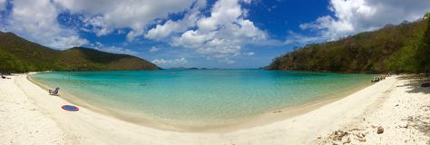 Tropical beach panorama overlooking white sand teal sea. Maho beach on St. John in the US Virgin Islands, surrounded by the crystal clear waters of the Caribbean Royalty Free Stock Photos
