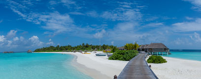 Tropical beach panorama view of the resort at Maldives Royalty Free Stock Images