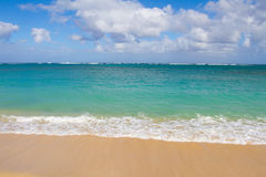 Tropical Beach Paradise. Beautiful tropical blue green water and a white sand beach on the north shore of Oahu in Hawaii. This image shows tropical paradise with Royalty Free Stock Photo