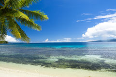 Tropical beach paradise Stock Images
