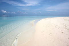 Tropical Beach Paradise. Crystal Clear azure waters of the tropics with a white sandy beach Royalty Free Stock Photo