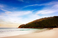 Tropical beach. Paradise. Blue sky, white sand, early morning Royalty Free Stock Photography
