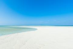 Tropical beach paradise, Okinawa, Japan. White sandy tropical beach paradise with clear water and sunny blue sky, Taketomi Island of the Yaeyama Islands, Okinawa Stock Images
