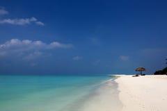 Tropical beach. Parasol on a tropical beach Royalty Free Stock Photo