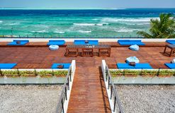 Tropical beach with patio deck. Summer vacation at Maldives stock photo