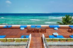 Tropical beach with patio deck. Summer vacation at Maldives royalty free stock image