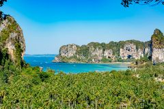 Tropical beach peninsula Railay. View from a lookout point at the mountains, forest and bay. Clear blue sky.Thailand.  stock photos