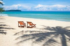 Tropical Beach Perfect Place For Relaxing, Empty Chairs And Shadow Palm Tree On The Beach Near The Sea royalty free stock image