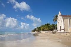 Tropical beach at Pernambuco, Brazil. Praia dos Carneiros: landscape of a tropical beach with a church, Pernambuco, Brazil Royalty Free Stock Images