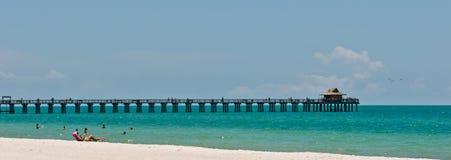 Tropical beach with a pier Stock Photos