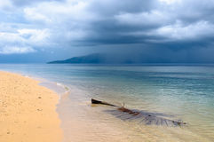 Tropical beach in a rainy weather Stock Images