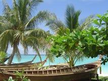 Tropical beach resort. Boats lying on Ko Phi Phi beach Royalty Free Stock Images