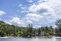 Tropical beach resort. Scenic view of tropical beach resort with blue sea in foreground Royalty Free Stock Photography