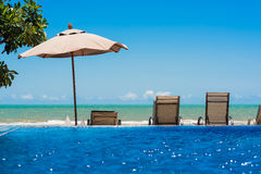 Tropical beach resort with chairs and umbrella Royalty Free Stock Photos