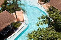 Tropical beach resort hotel swimming pool royalty free stock photography