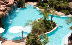 Tropical beach resort hotel swimming pool stock photo
