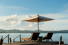 Tropical beach resort with lounge chairs and umbrellas in Phuket royalty free stock images