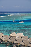 Tropical beach resort on moorea in south seas Royalty Free Stock Photography