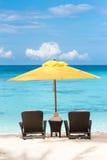 Tropical beach resort. Sun umbrella and beach chairs on tropical beach, Boracay Royalty Free Stock Image