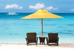 Tropical beach resort. Sun umbrella and beach chairs on tropical beach, Boracay Royalty Free Stock Photo
