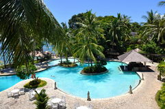 Tropical beach resort with swimming pool Stock Photos