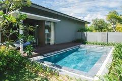 Tropical beach resort. Swimming pool near living room.  stock photography