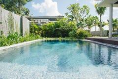 Tropical beach resort. Swimming pool near living room.  Royalty Free Stock Photos