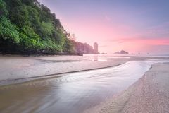 Tropical beach with river and colorful sky, Krabi. Beautiful tropical beach with river and colorful sky during sunrise or sunset Krabi, Thailand Stock Images