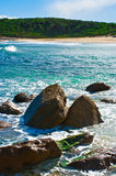 Tropical beach with rocks. In foreground royalty free stock image