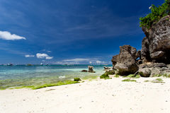 Tropical beach with rocks Stock Photo