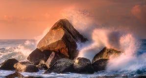 Tropical beach with rocks and big crashing waves. At sunset Mirissa, Sri Lanka Royalty Free Stock Image