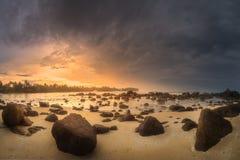 Tropical beach with rocks on sand coast of ocean Royalty Free Stock Photos