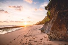Tropical beach with rocks and sunset or sunrise colors Royalty Free Stock Photos