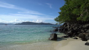 Tropical beach with rocks and tree. Tropical beach with rocks and tree stock video