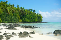 Tropical beach, rocks, white sand and trees. Royalty Free Stock Photos