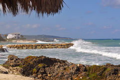 Tropical beach with rough surf. And coast line Stock Image