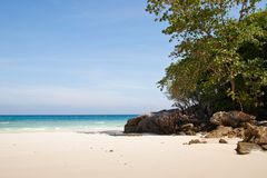 Tropical beach and sailboat Stock Photo